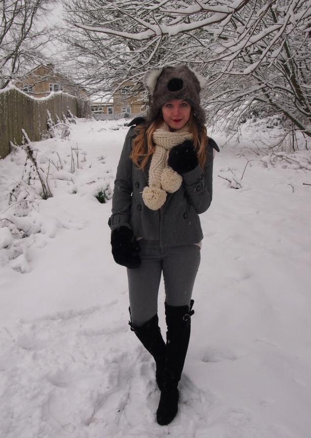 grey coat grey jeans black boots cream scarf Koala In The Snow