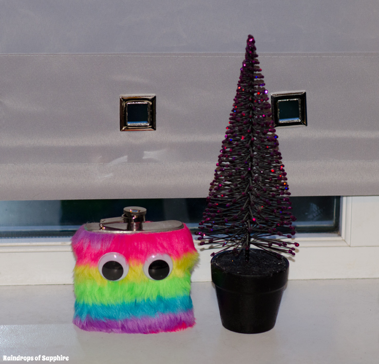 urban-outfitters-rainbow-fur-eyes-hip-flask-purple-glitter-christmas-tree
