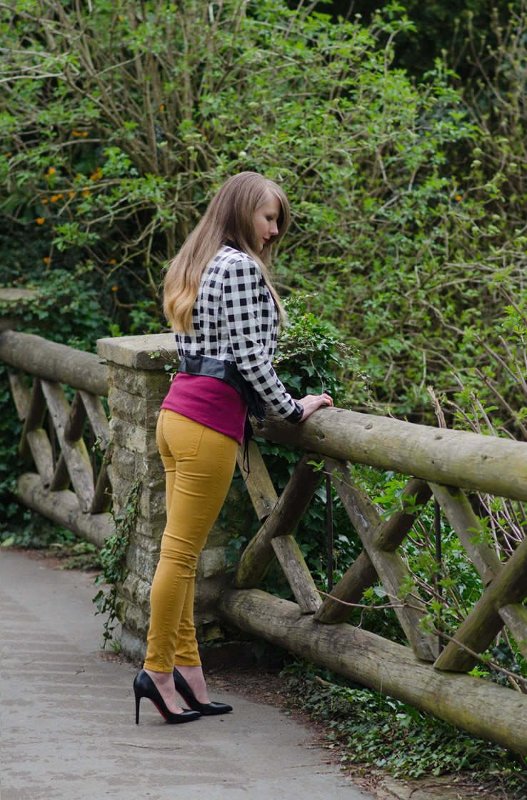 girl-leaning-over-bridge-park-tight-jeans