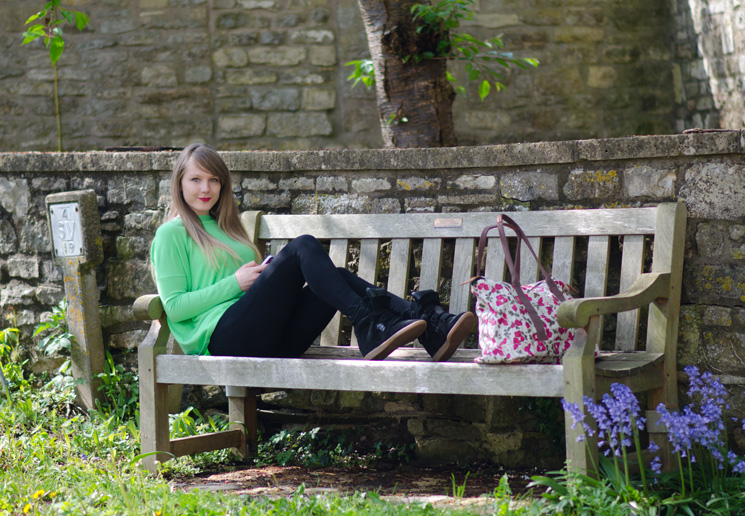 uk fashion blogger on bench Simply Green & Black