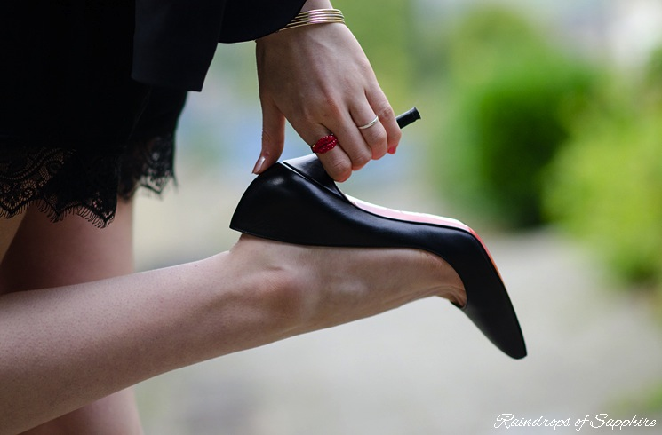 holding-heel-of-christian-louboutin-shoe