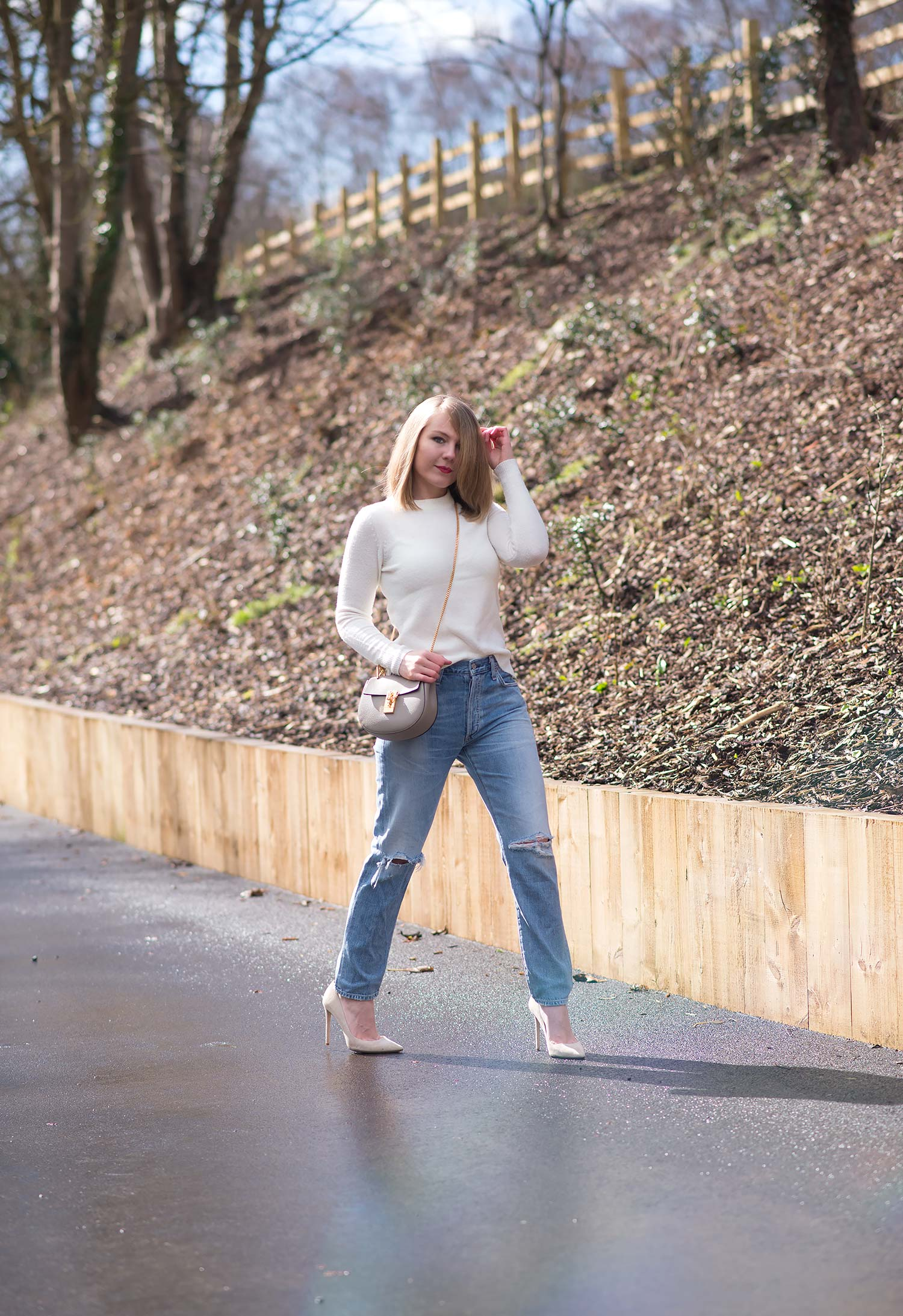 fashion blogger walking in citizens of humanity liya jeans