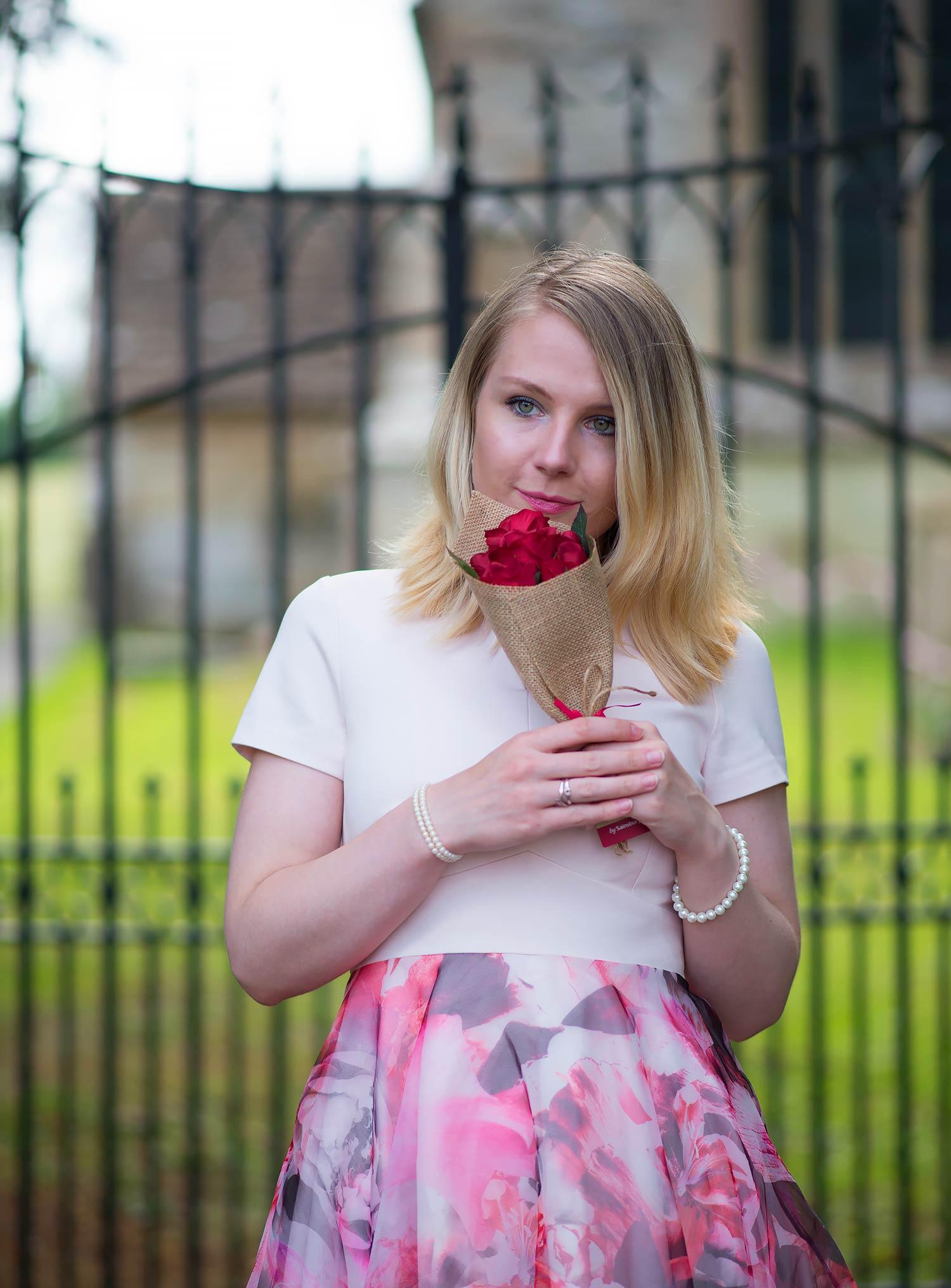 fashion blogger with dress and roses