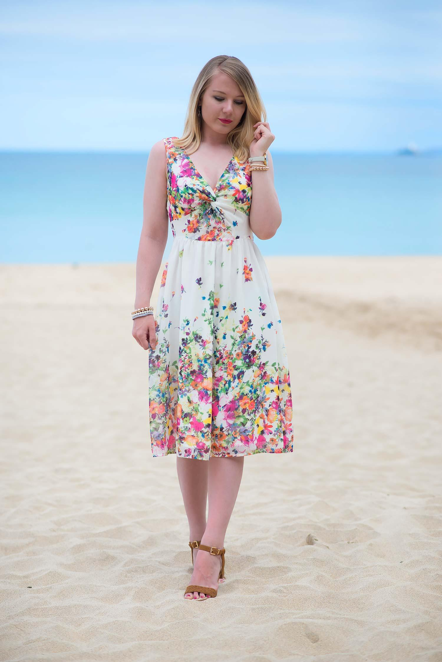 girl in white floral dress on beach
