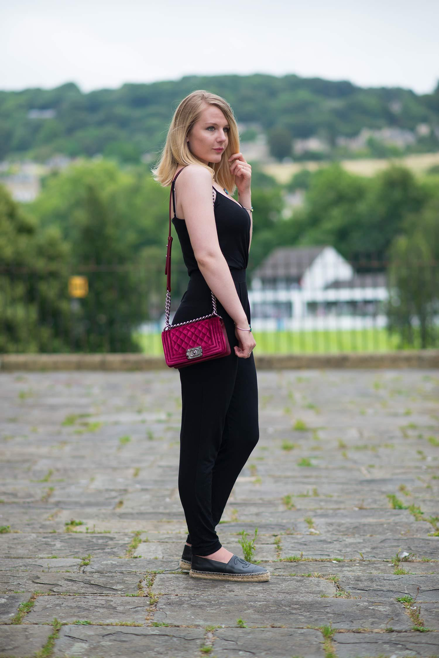fashion blogger in black jumpsuit