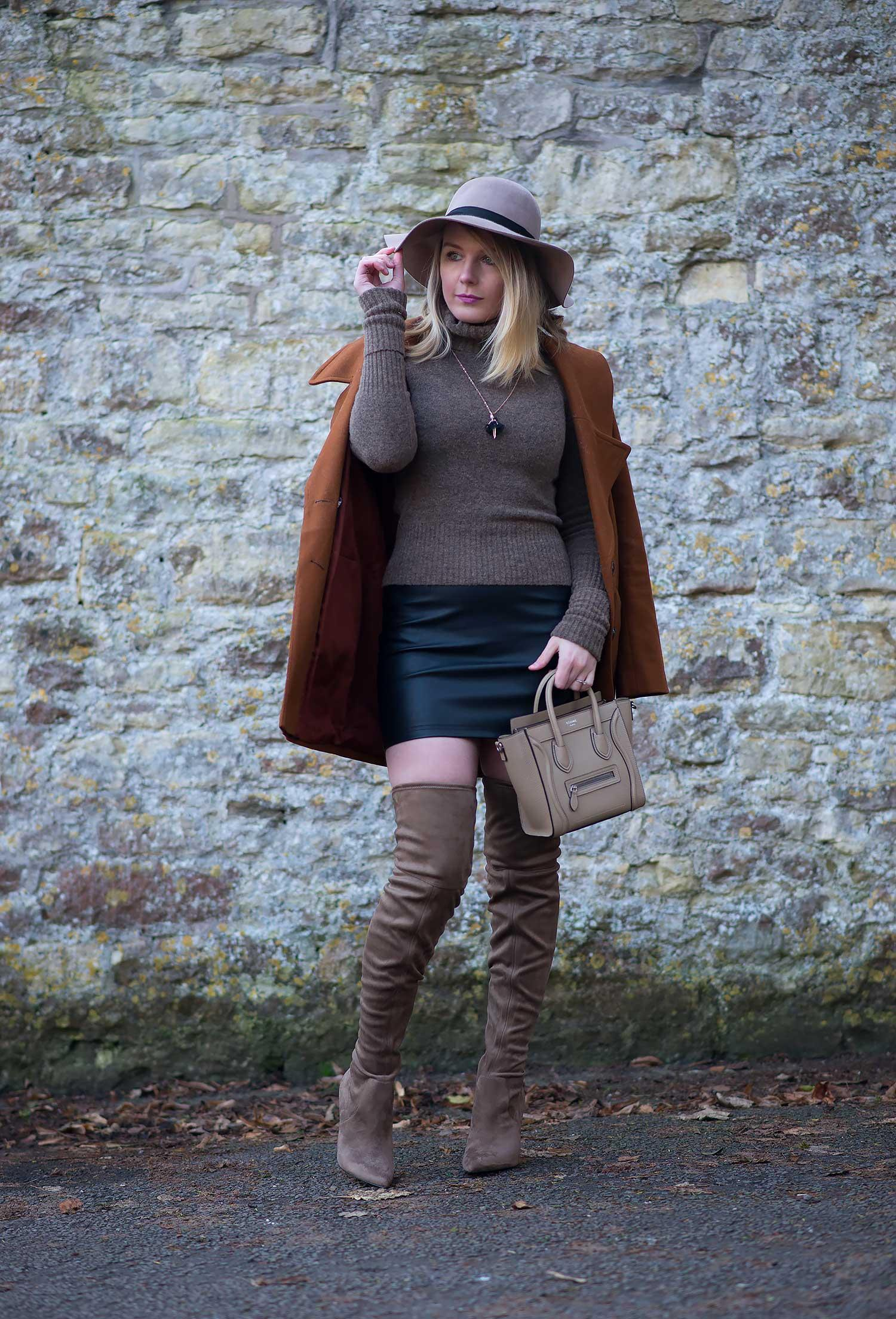 leather mini skirt with tan coat thigh high boots