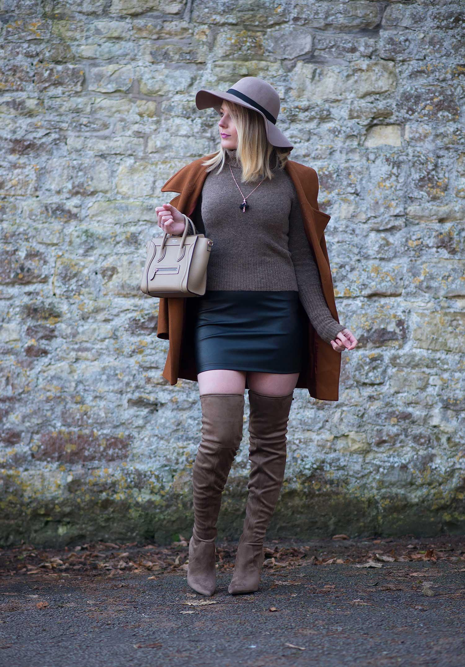 tan coat over shoulders with leather mini skirt outfit