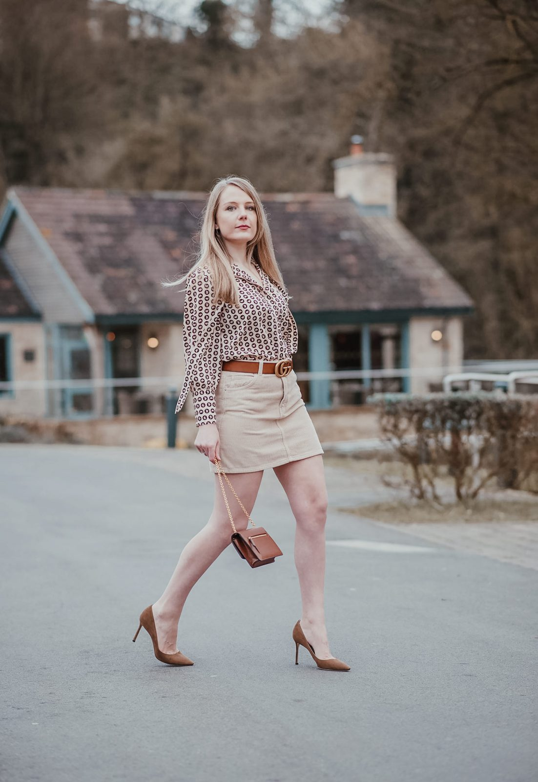 A Horse Coin Blouse With A Corduroy Skirt