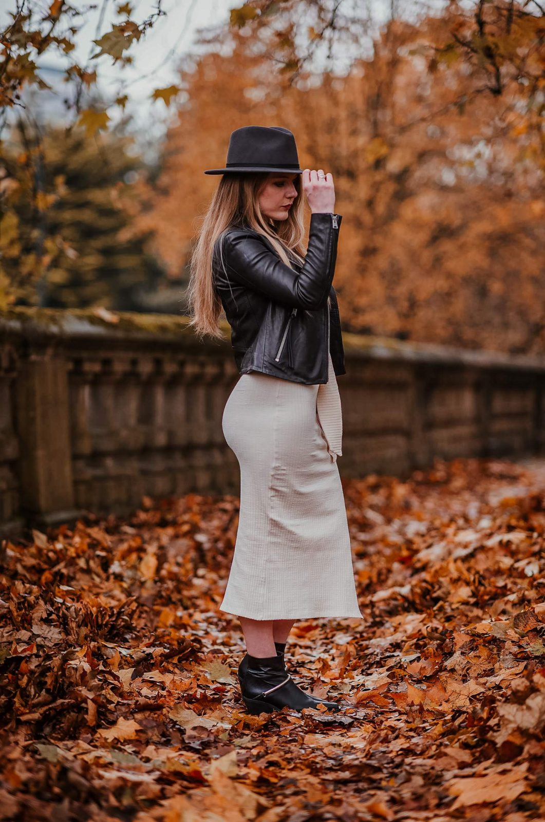 A Leather Jacket And Knitted Dress